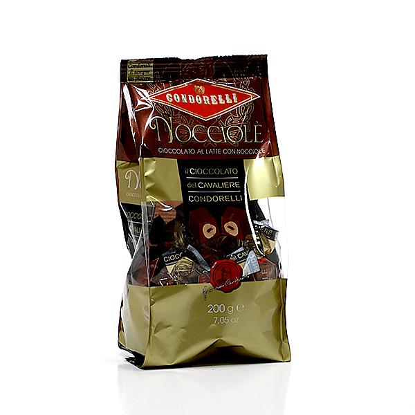 Pieniško šokolado saldainiai su lazdyno riešutais 200 g